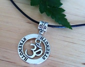 Strength ring yoga Om inspiration necklace on leather cord with sterling silver clasp