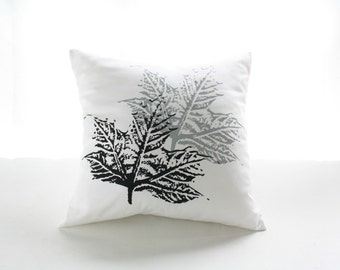 White Pillow cover with leaves screen printed on black and grey.