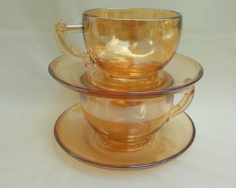 Jeanette Marigold Carnival Glass Pair of Cups and Saucers Moderne Iridescent Tea or Punch Cups