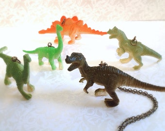 Miniature Dinosaur Necklace. Stand Up Dinosaurs. Natural History. Brown. Green. Oddities. Unisex. Brass. Vintage Style.