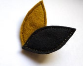 black and mustard leaf brooch sewn with golden thread