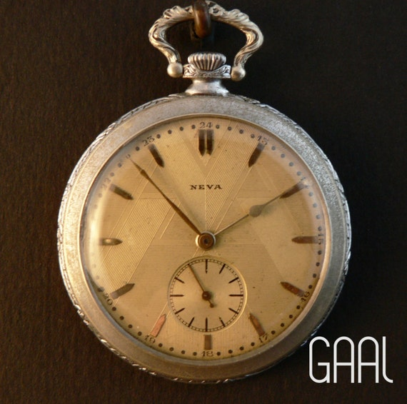Aged Neva pocketwatch vintage