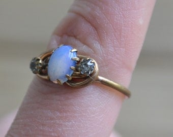 Beautiful antique victorian edwardian gold filled ring with faux opal and white rhinestones in knot design