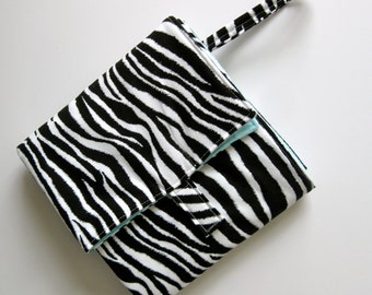 flip and go travel diaper changing pad/baby changing pad/travel diaper clutch with pockets gender neutral - zebra print with aqua
