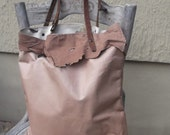 Genuine leather tote with canvas lining and military handle