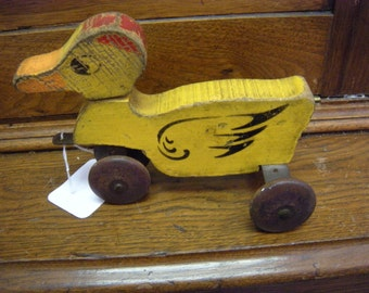 Antique wooden toy duck rolls and head turns hustler toy corp