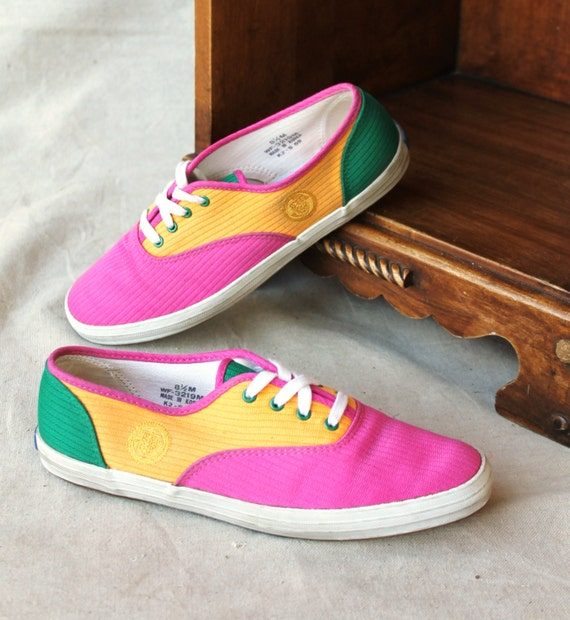 bright pink yellow teal green tennis shoe by by