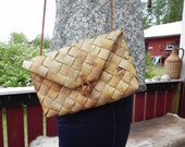 Stylish leather and wood handbag. Swedish folk art.