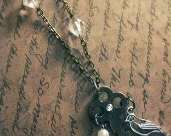 Elegant Key neckkace~ Vintage key necklace ~ with pearl bird and amber crystal bead dangles