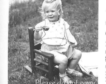 A little girl in her chair- Vintage Snapshot