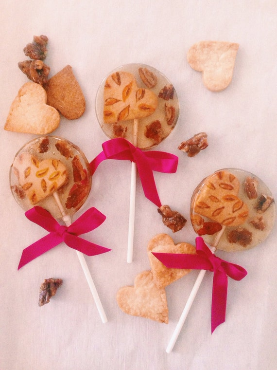 "3 Pecan ""pie"" lollipops with brown butter candied pecans and hand painted pie crust hearts"