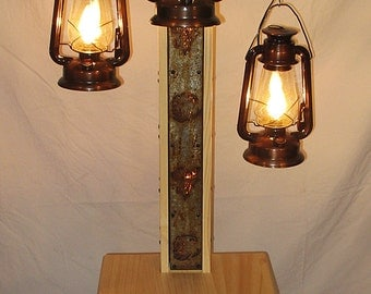Rustic floor lamp with old fashioned electrified kerosene lamps the