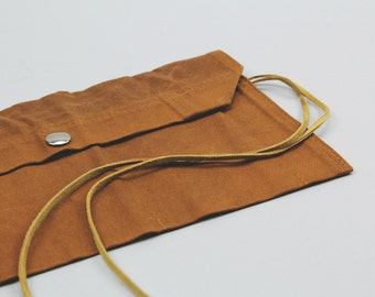 The Max Utility Roll // Caramel Brown Pocketed Accessory Roll with Tie Closure