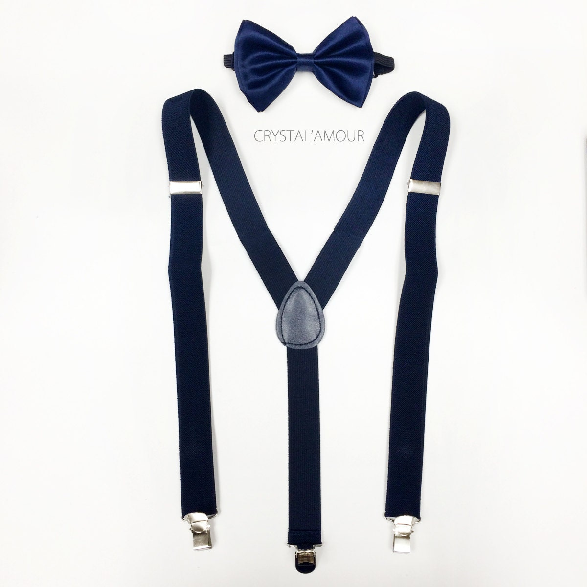These classic navy blue suspenders are perfect for everyday or formal wear. Adjustable from approximately to inches to fit most men. Holds securely in place with three silver-tone clips.