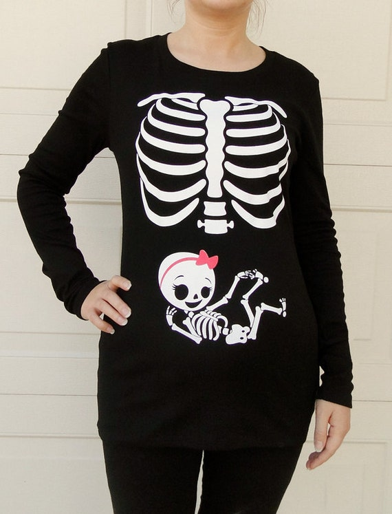 Halloween Maternity Shirts. Clothing. Maternity. Maternity Tops & T-Shirts. Maternity Graphic Tees. Halloween Maternity Shirts. Showing 48 of 67 results that match your query. Search Product Result. Product - Maternity Halloween Skeleton Face Long Sleeve Graphic Tee. Clearance. Product Image.