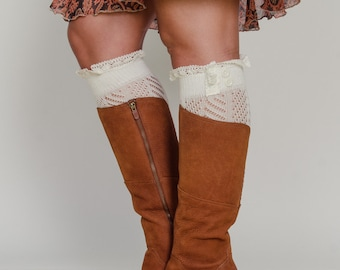 Ivory boot cuffs.  Pleasant and cozy, comfortable and versatile. Knitted Boot cuff with lace and buttons.