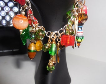 Jingle Jangle Bracelet.  Full of color and pieces to make a most colorful bangle bracelet