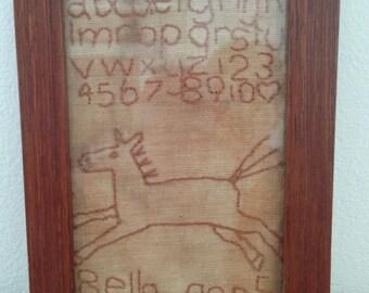 faux vintage sampler... 'bella aged 5'