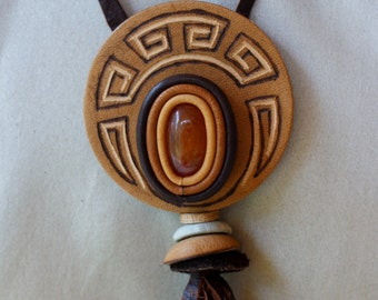 Leather pendant with semi-precious stones from Ural Mountains on leather cord.