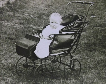 Cute Little Baby in Old Black Baby Buggy Pram - Vintage Real Photo Postcard - early 1900's