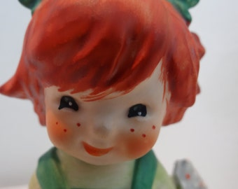 "GOEBELS, figurine,"" Dropping in"" bisque, hand painted , little girl with flowers in hand.circa 1970"
