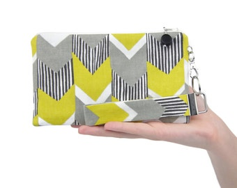 Geometric bag features a neutral fabric pattern with a pop of color - yellow & gray small clutch
