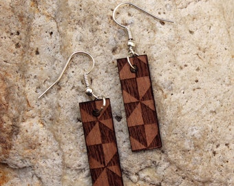 Doudou. Mahogany wood earrings are cut and engraved laser textured Doudou.