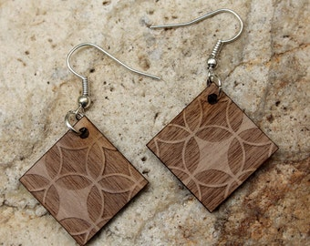 Woodstar. Walnut wood earrings are cut and engraved laser textured Woodstar.