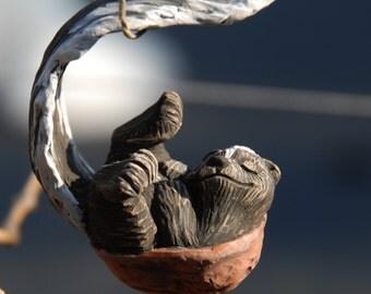 Sleeping Skunk Walnut Ornament