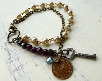 Vintage Bracelet with Garnet. Antique Key. Upcycled Coin. Vintage Pearls. Recycled Jewelry. Multi Chain