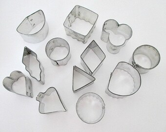 Collection of 12 Canape Hors D'oeuvre Cookie Cutters in Tin
