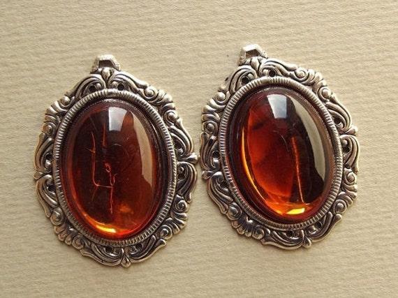 Vintage amber plastic cabochon pendants