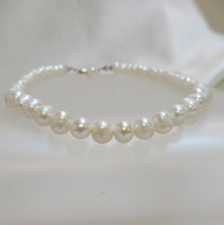 String Pearl Necklace: A String Of Freshwater Pearls Necklace