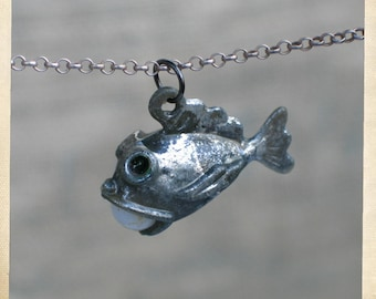 Vintage flapper fish charm in pewter finish. Thirties, forties  deadstock celluloid pendant