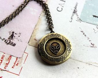 alien.  locket necklace. brass ox color
