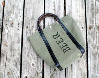 Beer Tote! 2 Growler or 1 - 6 pack capacity. Recycled from Army Tent Canvas & Bicycle Tubes.