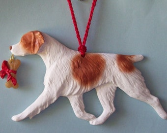 Brittany Spaniel with bone.  Dog breed sculpted artist ornament.