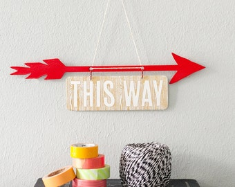 Red Arrow with letterpress signs