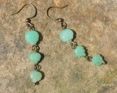 Three mint green chrysoprase carved leaves dangle earrings