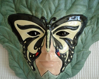 Ceramic Butterfly Mask Lady wall plaque with soft matte sage leaves
