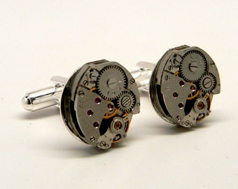 Steampunk cufflinks with vintage watch movement.