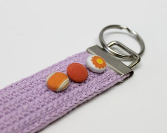 Lilac crocheted key chain with orange fabric covered buttons,lilac keychain,eco friendly,upcycled,crocheted keychain,ecofriendly keychain,