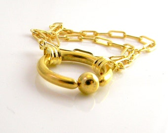 Golden Glow 14kt gold filled chain style slave bracelet with gold filled findings and a gold plated stainless steel clasp