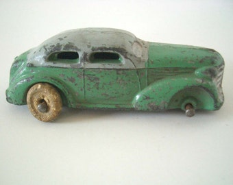 Vintage Cast Iron Two Tone Green and Silver Sedan Slush Mold Barclay