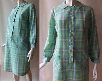 Vintage 1960's shirt dress, in lime green, blue, and white plaid, with long sleeves and patch pockets, medium / large