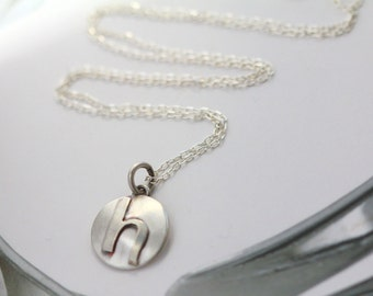 """Small lowercase inital letter """"h"""". Sterling silver disc necklace handmade by Norita Designs"""
