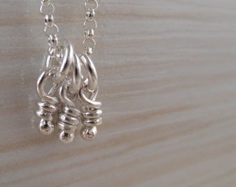 Sterling Silver Mini Knots Necklace. Tiny Dangling Whimsy Pendant. Knot Dangle Charm -Trio-