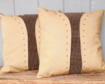 Large cream leather with chenille fabric insets pillow set