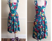 80s does 50s POPOVITCH vibrant floral print, adjustable strap, v-waist, full, tea length skirt, summer, day dress.