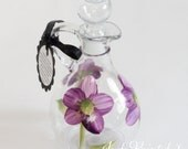 Oil and vinegar bottle that is hand painted in a floral purple daisy design- Dishwasher safe.
